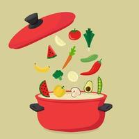 grande panela vermelha cheia de vegetais saudáveis