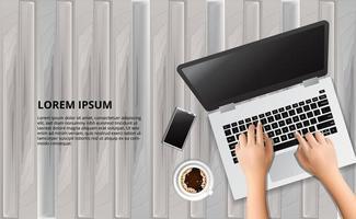 digitando laptop na mesa de madeira com ilustração