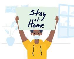 homem segurando um cartaz de ficar em casa