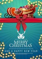 postal com fita, guirlanda e trenó de Papai Noel