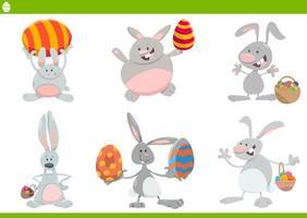 desenho animado conjunto de coelhinhos da páscoa vetor