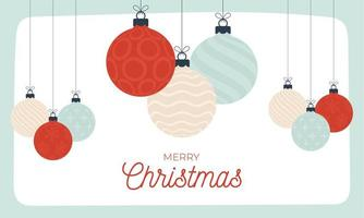 estilo retro do cartão de Natal. ilustração vetorial banner de ano novo com bolas de Natal. bugiganga decorativa em estilo cartoon plano com letras de saudação