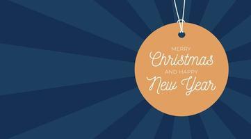 banner de venda de feliz Natal. etiqueta de preço redonda dourada pendurada em um fio em um fundo azul luxuoso com espaço vazio para texto