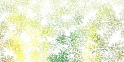 textura abstrata do vetor verde e amarelo claro com folhas.