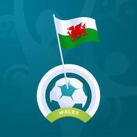 bandeira do vetor wales fixada a uma bola de futebol