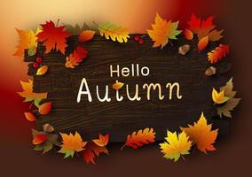 folhas de outono em fundo de madeira marrom vetor