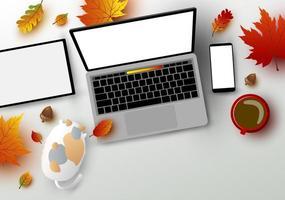 outono projeto de conceito de espaço de trabalho laptop computador tablet digital e maquete de smartphone com queda de folhas vetor