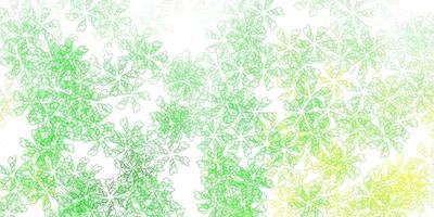fundo abstrato do vetor verde e amarelo claro com folhas.
