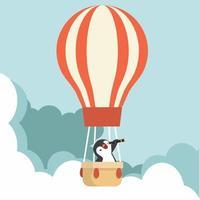 pinguim usando um telescópio com balão de ar quente