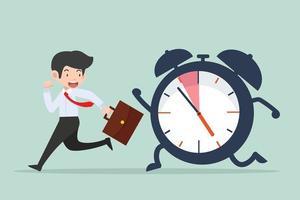 empresário correndo com um grande relógio temporizador tocando