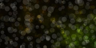 padrão de vetor verde e amarelo escuro com esferas.