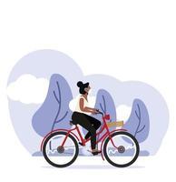 mulher andando de bicicleta e usando máscara médica