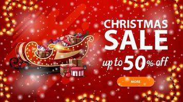 promoção de natal, desconto de até 50, banner vermelho de desconto com guirlanda, queda de neve e trenó de Papai Noel com presentes