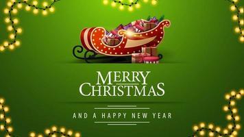 Feliz Natal e Feliz Ano Novo, cartão postal verde com guirlanda e trenó do Papai Noel com presentes