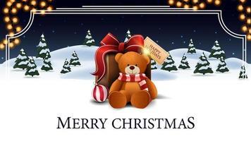 Feliz Natal, cartão-postal branco e azul com desenho animado floresta de inverno com abetos, céu estrelado, guirlanda e presente com ursinho de pelúcia