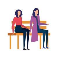 elegantes empresárias sentadas na cadeira do parque
