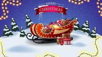 Feliz Natal, cartão postal com paisagem de inverno dos desenhos animados e trenó do Papai Noel com presentes