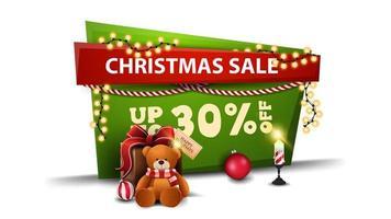 promoção de natal, desconto de até 30, banner de desconto verde e vermelho em estilo cartoon com guirlanda e presente com ursinho de pelúcia