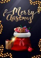 Feliz Natal, postal vertical azul com letras douradas e uma bolsa de Papai Noel com presentes