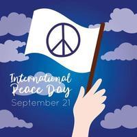 Dia internacional da paz letras com a mão acenando uma bandeira branca vetor