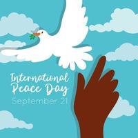 Dia internacional da paz letras com pomba e mão vetor