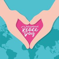 Dia internacional da paz letras com as mãos em forma de coração vetor