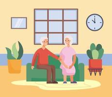 casal de idosos ativos na sala de estar