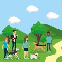 pessoas passeando com cachorros ao ar livre