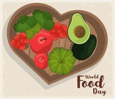 pôster do dia mundial da comida com legumes na placa de coração de madeira