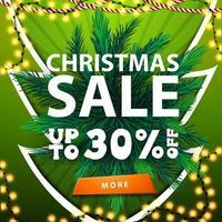 banner de venda de natal verde com guirlanda e galhos de árvore de natal vetor