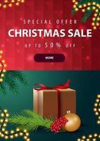 oferta especial, liquidação de natal, até 50 de desconto, banner vertical com desconto em vermelho e verde com presente e galho de árvore de natal