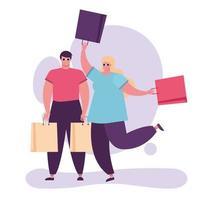 jovem casal com sacolas de compras