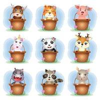 conjunto de desenhos animados de animais fofos na cesta, o personagem de porco fofo, iaque, tigre, unicórnio, rinoceronte, guaxinim, hipopótamo, panda e veado vetor