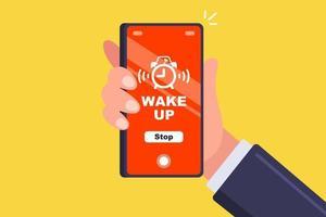 um despertador em um telefone celular vibra na mão de um homem. ilustração vetorial plana