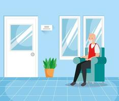 velho na sala de espera
