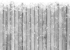 Flocos de neve de Natal em fundo de madeira vetor