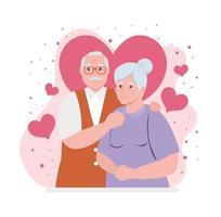 casal de idosos sorrindo com decoração de corações