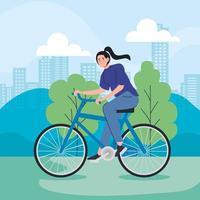 jovem andando de bicicleta ao ar livre