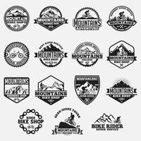 Conjunto de logotipos e emblemas de mountain bike vetor