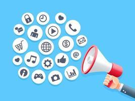mão humana segurando o megafone com conceito de ícones de mídia social de bolha.