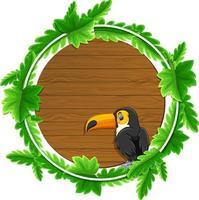 modelo de banner de folhas verdes redondas com um personagem de desenho animado tucano vetor