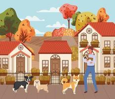 jovem com cachorros bonitos ao ar livre