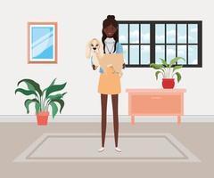 jovem afro levantando um cachorro fofo dentro de casa vetor