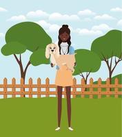 jovem mulher afro levantando um cachorro fofo no campo vetor
