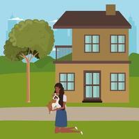 jovem mulher afro levantando um cachorro fofo ao ar livre da casa vetor