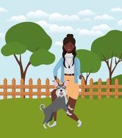 jovem mulher afro com um cachorro fofo no campo