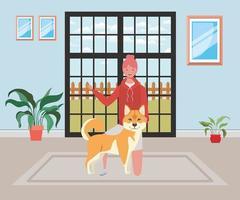 jovem mulher com cachorro fofo na sala de casa