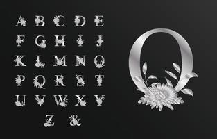 lindo alfabeto prateado para casamento com flor