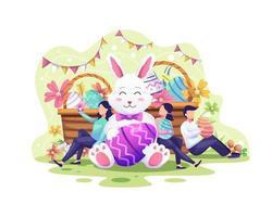 pessoas felizes celebram o dia de páscoa com um coelho, cestas cheias de ovos de páscoa e flores vetor