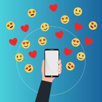smartphone com mão e emojis